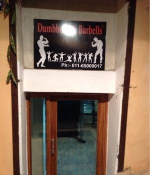 Dumbbells And Barbells Gym